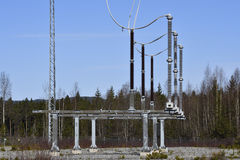 Surge arresters on a high voltage line. Picture from the North of Sweden royalty free stock images