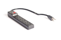 Surge Protector. A black surge protector isolated on white stock images