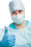 Surgeon. With thumbs up and doctors behing him, isolated Royalty Free Stock Photo