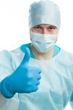 Surgeon. With thumbs up and doctors behing him, isolated Royalty Free Stock Photography