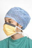 Surgeon. A female surgeon in her sterile surgical clothes Royalty Free Stock Photo