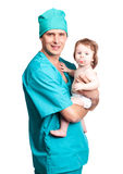 Surgeon with a baby. Portrait of a surgeon holding a  baby, isolated against white background Royalty Free Stock Image