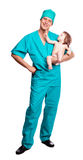 Surgeon with a baby. Portrait of a surgeon holding a  baby,  against white background Stock Photos