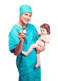 Surgeon with a baby. Portrait of a surgeon with a stethoscope holding a  baby, isolated against white background Royalty Free Stock Photos