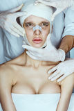 Surgeon or beautician hands touching woman face Royalty Free Stock Photo