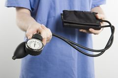 Surgeon With Blood Pressure Gauge Royalty Free Stock Photos
