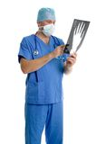 Surgeon checking an x-ray. Stock Photo