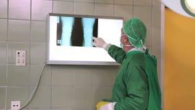 Surgeon checking xrays Royalty Free Stock Photos