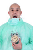 Surgeon and clock alarm Stock Images