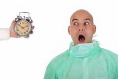 Surgeon and clock alarm Royalty Free Stock Photography