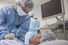 Surgeon consulting a patient, getting ready for surgery Royalty Free Stock Photo