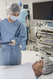 Surgeon consulting a patient, getting ready for surgery Stock Photography