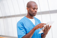 Surgeon with digital tablet. Royalty Free Stock Images