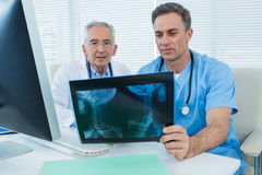 Surgeon and doctor discussing x-ray report. In clinic Stock Images