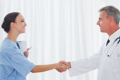 Surgeon and doctor shaking hands Stock Photo