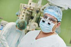 Surgeon doctor in surgery operation room Stock Photos