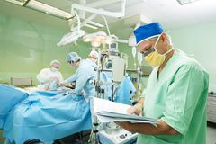 Surgeon doctor in surgery operation room. Male surgeon in uniform in front of cardiac surgery operation room at clinic Stock Photo