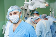 Surgeon doctor in surgery operation room Stock Images