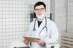 Surgeon doctor with tablet computer in hospital office. Medical healthcare staff and doctor service royalty free stock images