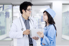 Surgeon and doctor with tablet Stock Photography