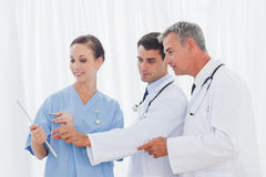 Surgeon and doctors interpreting results together Stock Image