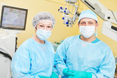 Surgeon doctors in operation room Royalty Free Stock Photos