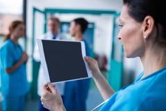Surgeon examining a report Royalty Free Stock Photo