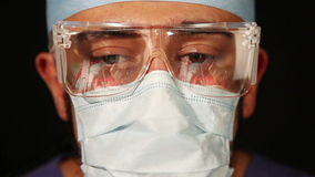 Surgeon with Eyeglasses. Surgeon with Reflections in Eyeglasses stock video footage