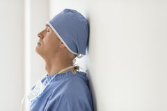 Surgeon With Eyes Closed Leaning On Wall In Ho Stock Photos