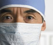 Surgeon with face mask stock image