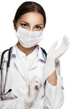 Surgeon female. Young woman doctor in face mask isolated on white background Stock Image