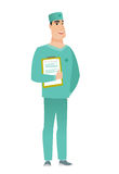 Surgeon holding clipboard with papers. Caucasian surgeon in uniform holding clipboard with papers. Full length of surgeon with papers. Young smiling surgeon Stock Photography