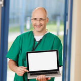 Surgeon Holding Laptop In Clinic Royalty Free Stock Images