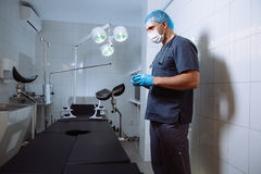 Surgeon holding medical instruments in hands. Concept of a healthy Royalty Free Stock Photos