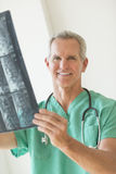 Surgeon Holding X-Ray Report In Clinic Royalty Free Stock Photography