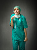 Surgeon indicated with stupid faces Royalty Free Stock Photo