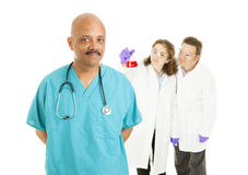 Surgeon and Lab Techs Royalty Free Stock Image