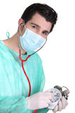 Surgeon listening to an alarm Royalty Free Stock Photography