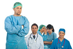 Surgeon man and gossip colleagues Stock Photos