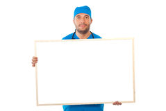 Surgeon man holding blank banner stock photo