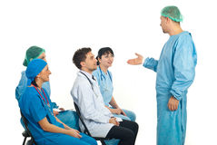 Surgeon man talking with doctors at seminar Stock Image