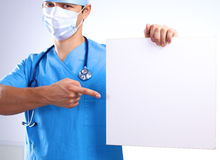 Surgeon in the mask holds a placard Stock Image
