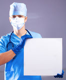 Surgeon in the mask holds a placard Stock Photo