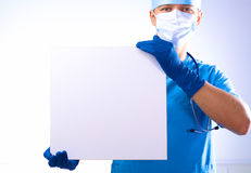 Surgeon in the mask holds a placard Royalty Free Stock Photography