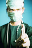 Surgeon medic with scalpel. Surgeon medic with a scalpel. Focus on scalpel royalty free stock photo