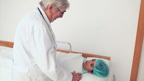 Surgeon next to a patient Royalty Free Stock Images