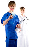 Surgeon and nurse Stock Images