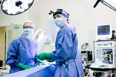 Surgeon and nurse Stock Image