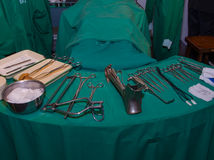 Surgeon and old surgical tools. Royalty Free Stock Image