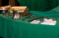 Surgeon and old surgical tools. Stock Photo